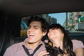 A couple in the back of a taxi