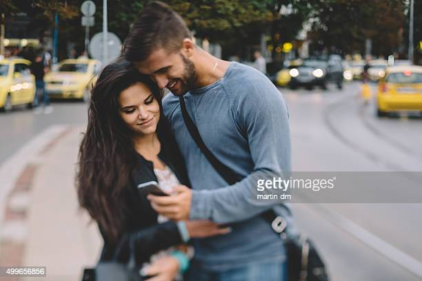 Couple in the city texting