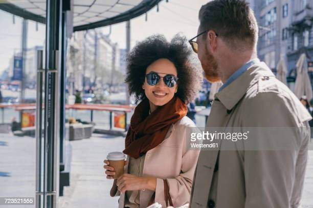 Couple in the city with takeaway coffee