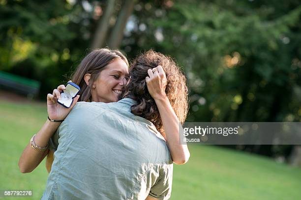 Couple in the park: Wedding proposal engagement