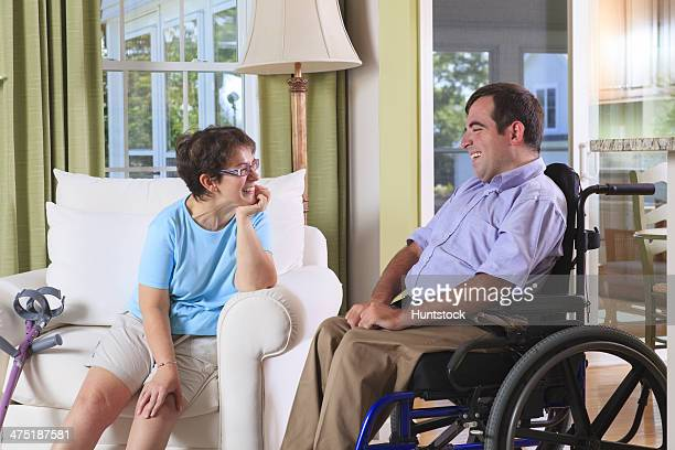 Couple in their home both with Cerebral Palsy