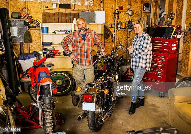 Couple in their motorcycle garage