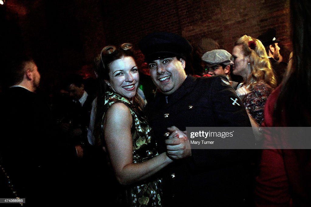 A couple in wartime costume dance to swing band 'The Red Roosters' as they attend The Blitz Party on February 22, 2014 in London, England. Deep in an East End bunker hundreds of vintage enthusiasts partied like it was 1940 in a range of vintage costumes. They danced to Swing and Jazz music from the era and drank themed cocktails ordered at the Spitfire Bar, as they embraced the glamour of the era.
