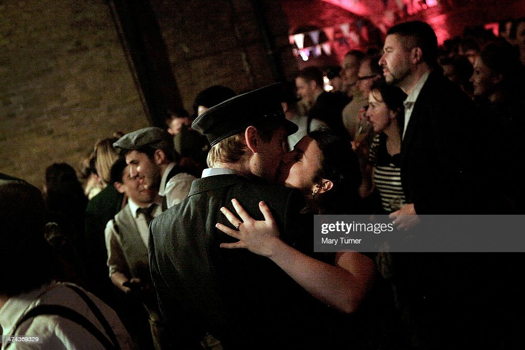 A couple in wartime dress embrace on the dancefloor during The Blitz Party on February 22, 2014 in London, England. Deep in an East End bunker hundreds of vintage enthusiasts partied like it was 1940 in a range of vintage costumes, dancing to Swing and Jazz music while drinking themed cocktails, as they embraced the glamour of and nostalgia for the era.