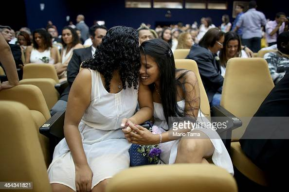 Couple Ingrid and Tamires embrace before marrying at what was billed as the world's largest communal gay wedding on December 8 2013 in Rio de Janeiro...