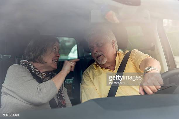 Couple inside car arguing