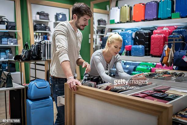 Couple inside luggage store