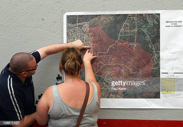 A couple inspect a map outling the fire damage are during a FESA community briefing on February 7 2011 in Perth Australia Fire and Emergency Services...
