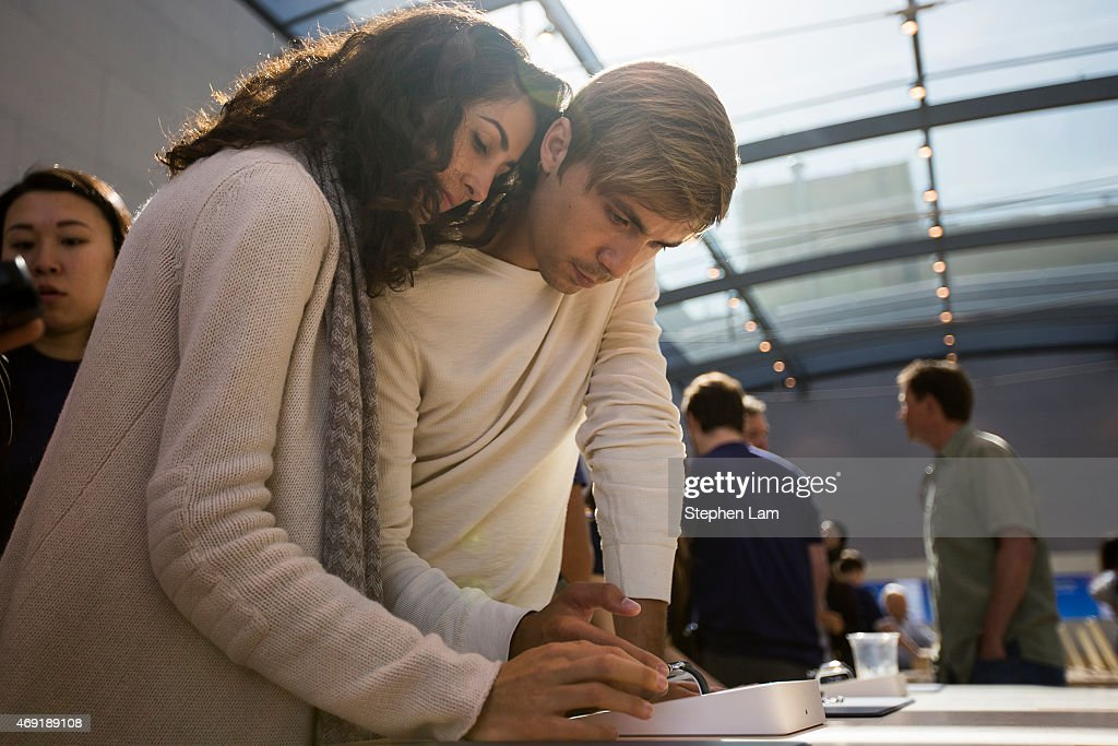 A couple interact with an Apple Watch at an Apple Store on April 10, 2015 in Palo Alto, California. The pre-orders of the highly-anticipated wearable from the tech giant begin today as the watches arrive at stores for customers to preview.