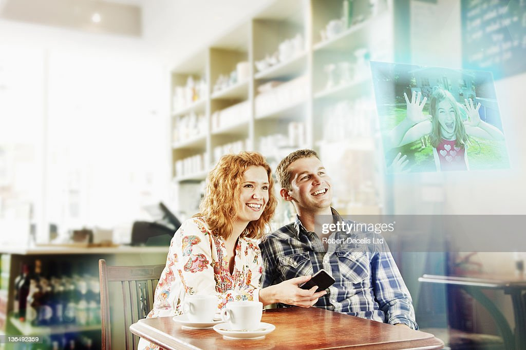 Couple interating with child on smart phone : Stock Photo