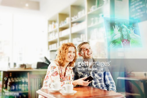 Couple interating with child on smart phone : Foto stock