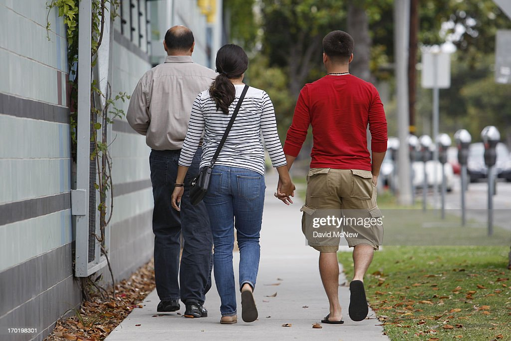 A couple is escorted to Santa Monica College, which remains closed for a second day as investigators gather evidence from crime scenes, to pick up personal belongings that were abandoned when a gunman on a mass shooting spree entered the campus on June 8, 2013 in Santa Monica, California. The shootings occurred in various locations about three miles south of a political fundraiser attended by President Barack Obama but Secret Service officials said the two events were not related and that the president was never in any danger. Four people besides the gunman have died from their wounds and five others wounded, including a woman who is close to death.