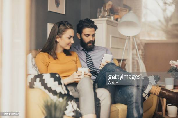 Couple is having a morning coffee together before leaving for work