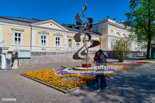 A couple is kissing at an Art Nouveau Building in the green city centre of Meran in South Tyrol on April 21 2015 in Lana Italy