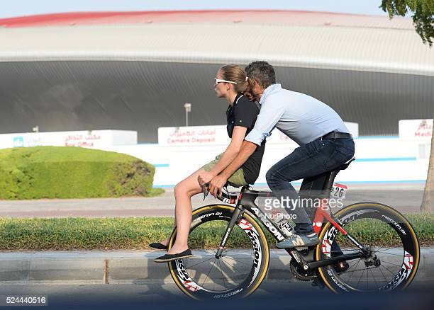 A couple is riding on Paul Voss bike near the Yas Mall Abu Dhabi UAE 9 October 2015