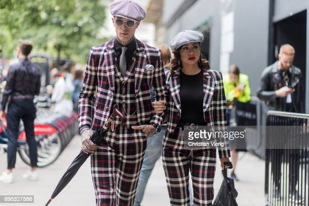 Couple Jimmy Q and Jet Luna wearing flat cap and checked suits during the London Fashion Week Men's June 2017 collections on June 12 2017 in London...