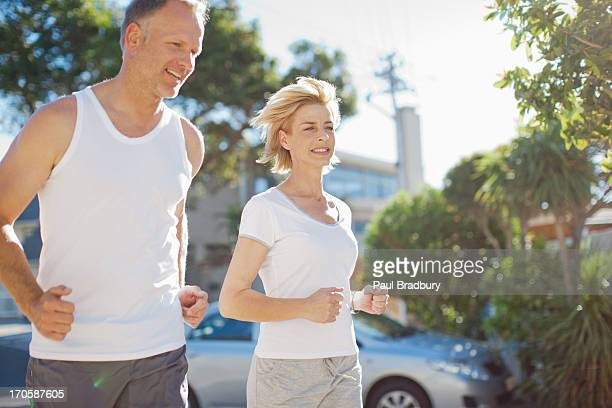 Couple jogging in neighborhood