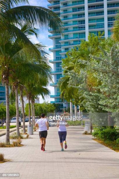 Couple jogging on Downtown Miami path