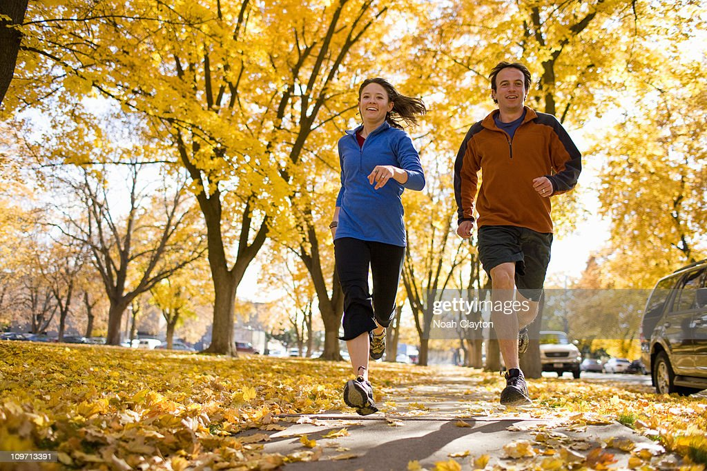 Couple jogging on path in Autumn : Stock Photo
