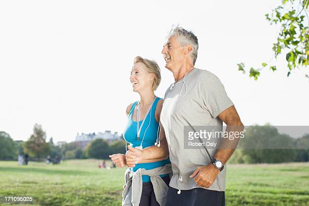 Couple jogging together outdoors