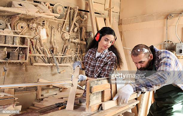 Couple joiners working in their workshop