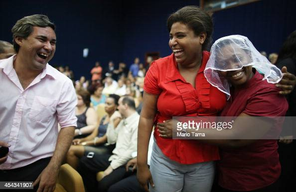 A couple jokes around before getting married at what was billed as the world's largest communal gay wedding on December 8 2013 in Rio de Janeiro...