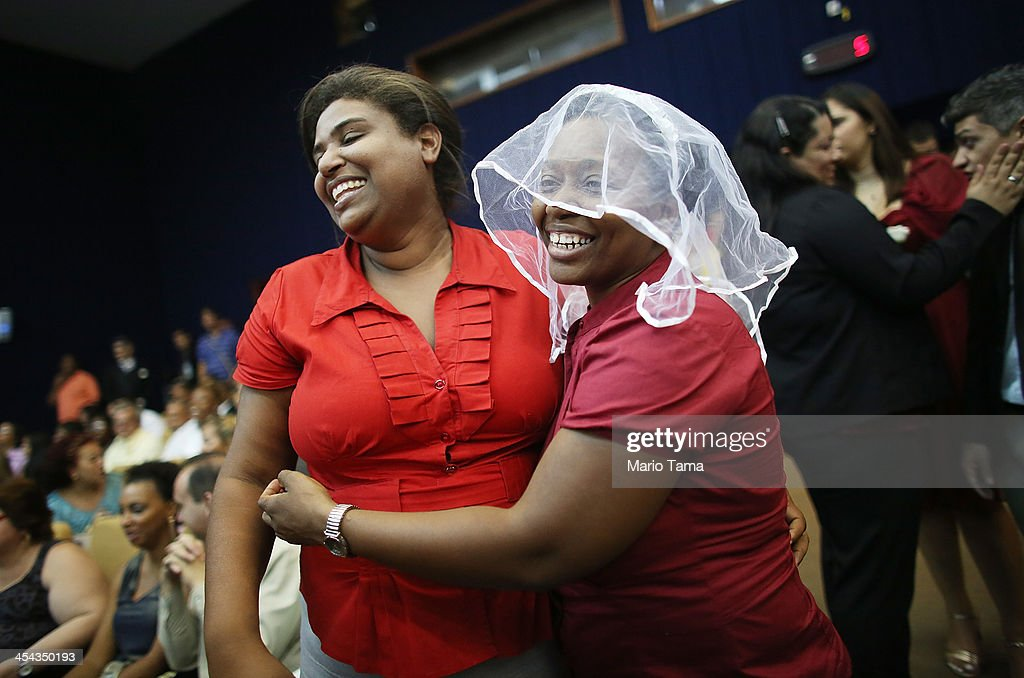A couple jokes around before getting married at what was billed as the world's largest communal gay wedding on December 8, 2013 in Rio de Janeiro, Brazil. 130 couples were married at the event which was held at the Court of Justice in downtown Rio. In May, Brazil became the third country in Latin America to effectively approve same-sex marriage via a court ruling, but a final law has yet to be passed.