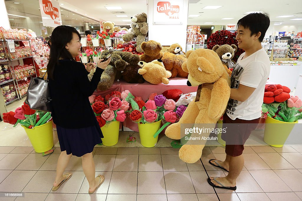 A couple jokes around in a mall selling Valentine's day gift items at Orchard Road on February 14, 2013 in Singapore. Valentine's Day is a time to celebrate love, romance and friendship and is celebrated worldwide annually in different ways on February 14.