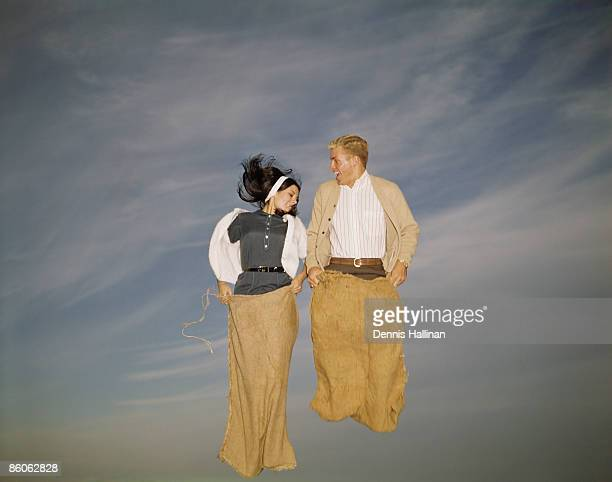 Couple Jumping in Potato Sack Race