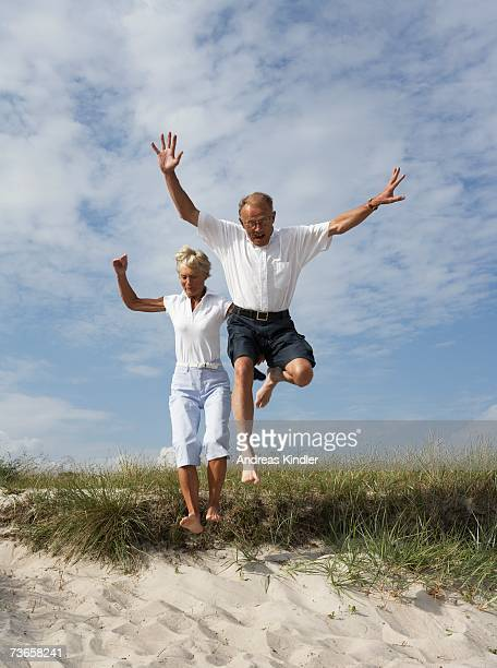 Couple jumping.