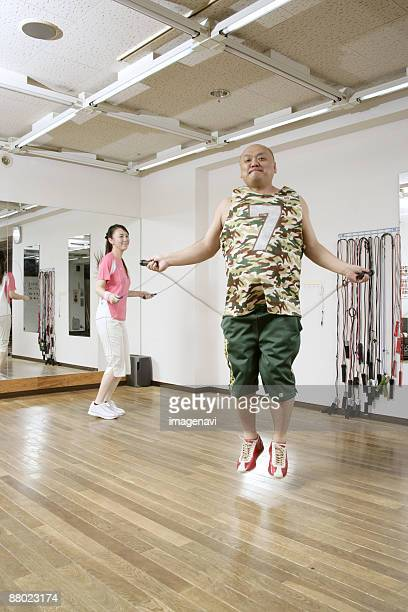 Couple jumping rope