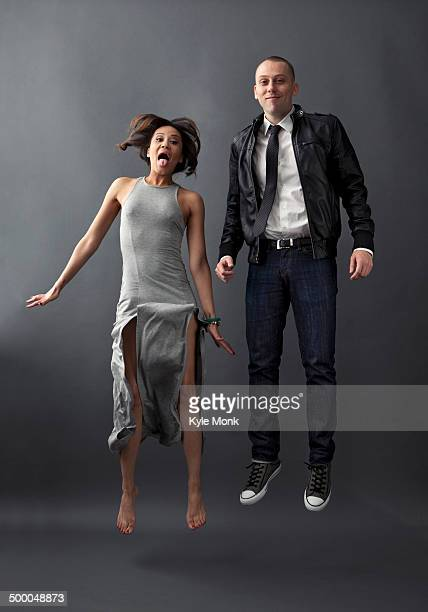 Couple jumping together in studio