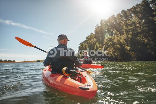 Couple kayaking in the lake on a sunny day : Stock Photo