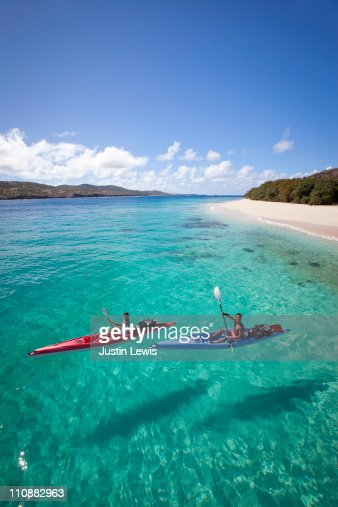 Couple kayaking in tropical setting : Stock Photo