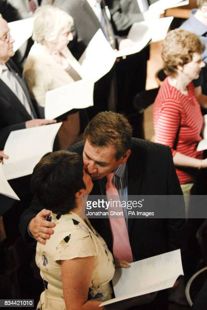 A couple kiss as hundreds of couples at Westminster Cathedral in London renew their vows at a special mass