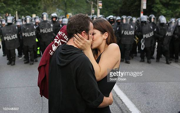 A couple kiss in front of the police line during a protest against the G20 summit June 26 2010 in Toronto Canada The kiss was interupted as police...
