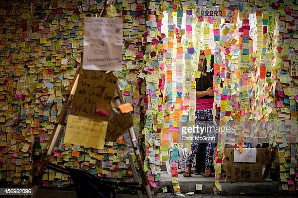 A couple kiss inside a room filled with prodemocracy sticky note messages outside Hong Kong's Government complex on October 10 2014 in Hong Kong Hong...