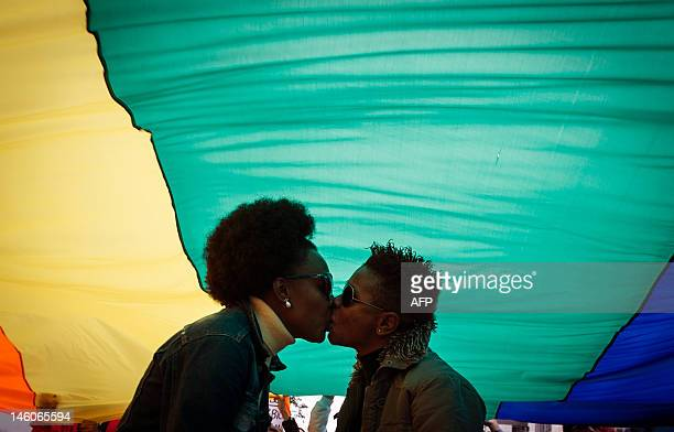 A couple kiss under the rainbow flag during the10th lesbian and bisexual parade to protest against injustice and to promote the fight for their...