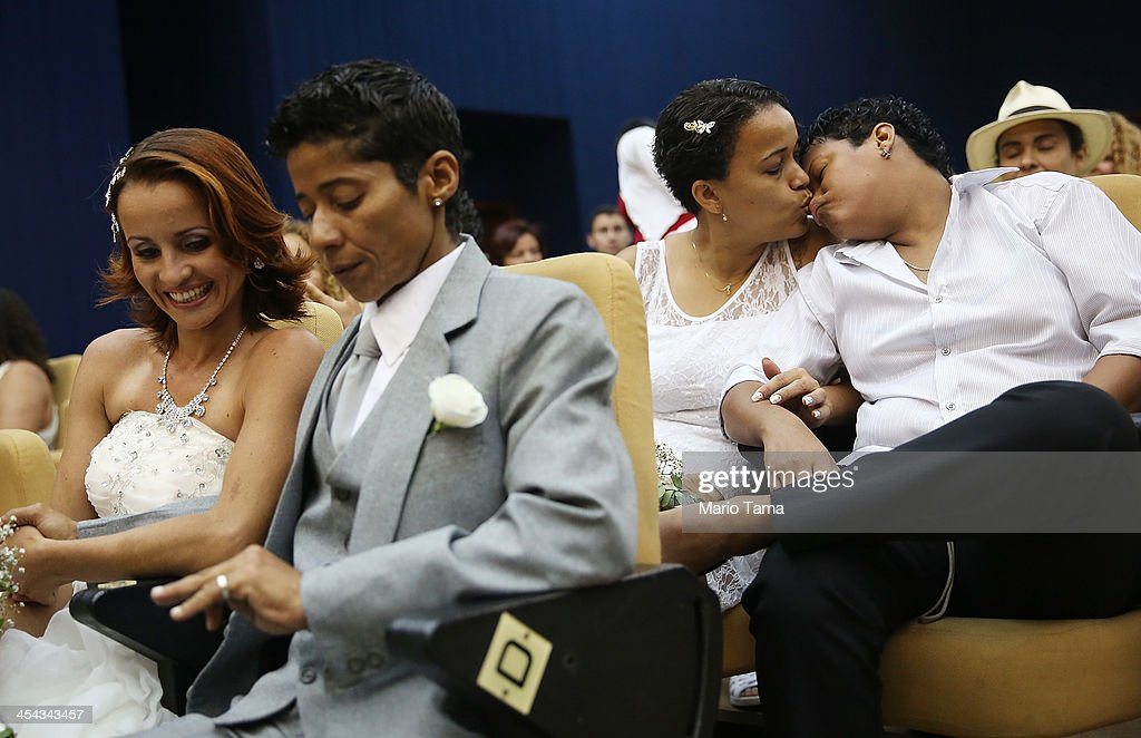 A couple kisses before getting married at what was billed as the world's largest communal gay wedding on December 8, 2013 in Rio de Janeiro, Brazil. 130 couples were married at the event which was held at the Court of Justice in downtown Rio. In May, Brazil became the third country in Latin America to effectively approve same-sex marriage via a court ruling, but a final law has yet to be passed.
