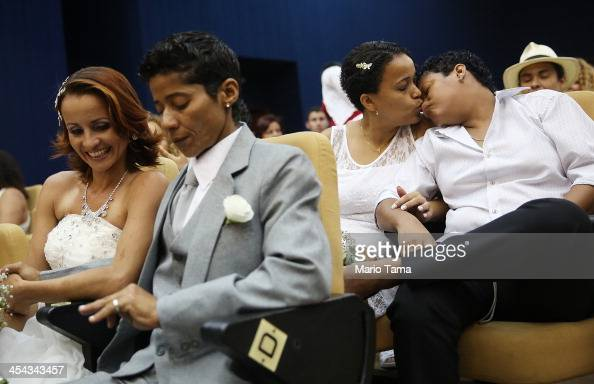 A couple kisses before getting married at what was billed as the world's largest communal gay wedding on December 8 2013 in Rio de Janeiro Brazil 130...