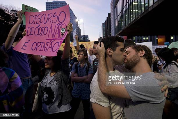 A couple kisses during a protest against the homophobic speech by Brazilian presidential candidate for the Labour Renewal Party Levy Fidelix during...
