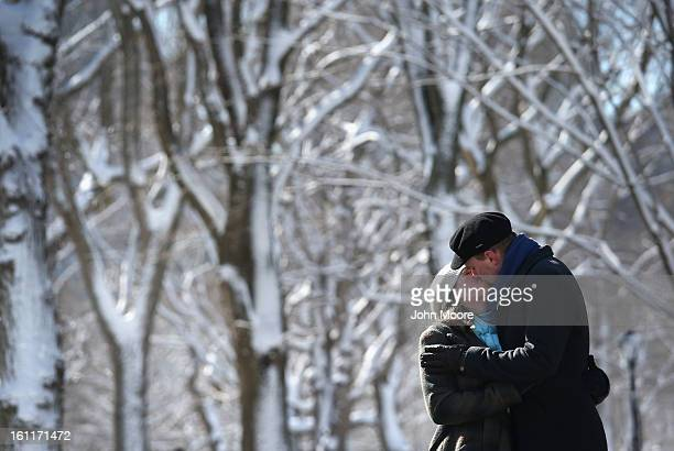 A couple kisses in a snowcovered Central Park on February 9 2013 in New York City The park received almost a foot of snow as New York was spared the...