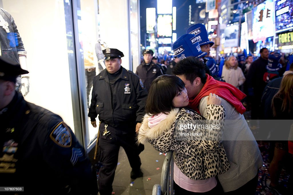 A couple kisses in Times Square just before the annual ball drop December 31, 2010 in New York City. This year a 11,875-pound Waterford crystal ball descended a 141-foot tall flagpole to mark the beginning of 2011.