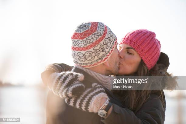 Couple kissing and hugging each other