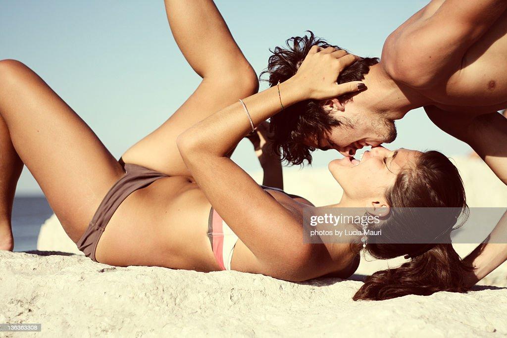 Couple  kissing at seaside : Stock Photo