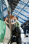 Couple kissing by train