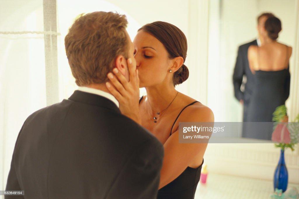 couple kissing in bathroom stock photo