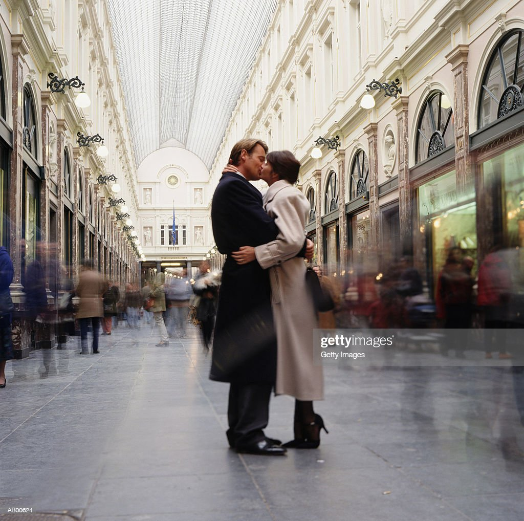 Couple kissing in gallery, St. Hubert, Brussels, Belgium : Stock Photo