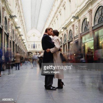 Couple kissing in gallery, St. Hubert, Brussels, Belgium : Stock Photo