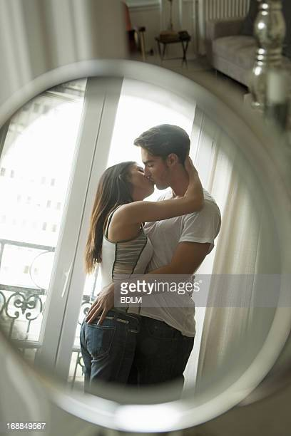 Couple kissing in mirror